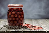 Preserved cherries in a glass jar