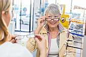 Woman buying glasses in pharmacy