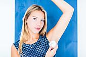 Woman using alumstone as deodorant