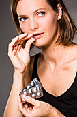 Woman taking statin cholesterol-lowering pills