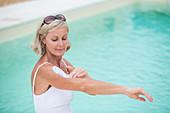 Woman applying sunblock