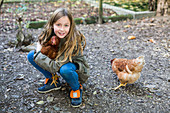 Child with hens