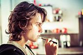Teenager smoking electronic cigarette