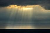 Shafts of sunlight over Bristol Channel, UK