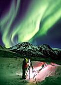 Photographer and the aurora in Alaska