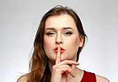 Woman with finger to her lips