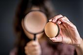 Woman watching an egg