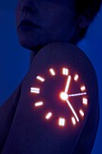 Woman with clock projected on shoulder