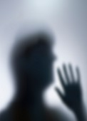 Silhouette of person's head and hand