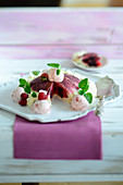Summer pudding with strawberry ice cream