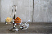 Various spice mixtures in glass bowls