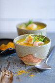 Curry and mango soup with prawns