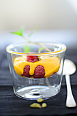 Spiced cream with raspberries