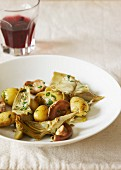 Small potatoes, artichokes and mushrooms with parsley