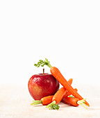 A red apple and carrots