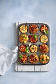 Various savoury muffins in a muffin tin