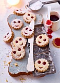 Schlawiner (jam biscuits with smiley faces)