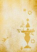 Abdrücke von Weihnachtsmotiven in Puderzucker auf Golduntergrund