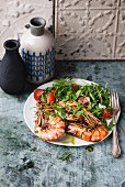 Fried prawns and rocket salad