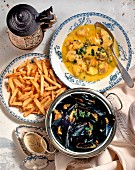 Cod soup, mussels with mustard sauce and chips