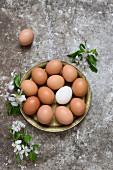 Fresh eggs in a brass bowl