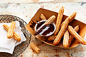 Churros con chocolate (deep-fried pastries, Spain)