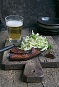 Fried bacon with pointed cabbage slaw