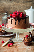 Chocolate cake with chocolate icing and raspberries