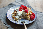 Gluten-free banana pancakes with raspberries and chia seeds