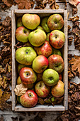 Fresh apples in wooden crate
