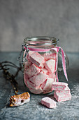 Homemade raspberry marshmallows in a jar