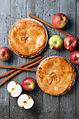Apple pies with fresh apples and cinnamon