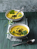 Turmeric and coconut soup with roasted black lentils