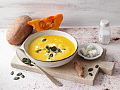 Sweet potato and pumpkin soup with turmeric and feta