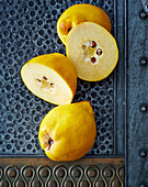 Quinces, whole and halved