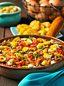 Spicy minced beef hash with egg and olives (Cuba)