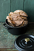 Coarse-grained no-knead rye bread in a pan