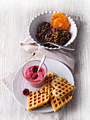 Chocolate rice pudding with clementines, and millet waffles with raspberry quark