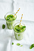 Wheatgrass smoothie with pear, apple, avocado, lamb's lettuce and coconut