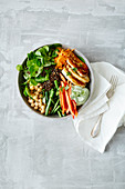 Lentil and halloumi bowl with vegetables