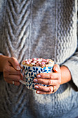 Hot chocolate with Marshmallows in hand