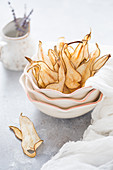 Pear crisps in a ceramic bowl