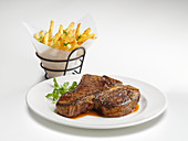 A porterhouse steak with french fries