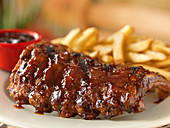 Spare ribs with barbecue sauce and fries