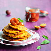 Vegan pumpkin fritters with plum compote
