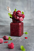 Frozen smoothie sorbet with raspberries, cashew milk and acai