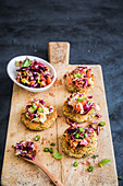 Sesame and potato patties with red cabbage salad