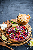 Red cabbage pico de gallo with tortilla chips