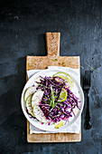 Red cabbage salad with pears and sprouts