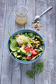Spinach salad with avocado, watermelon and alfalfa shoots